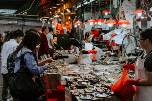 A worker serves food in a market in China